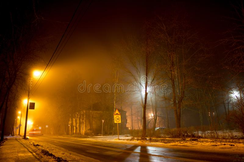 A sleeping area with scattered light during a night fog royalty free stock photos