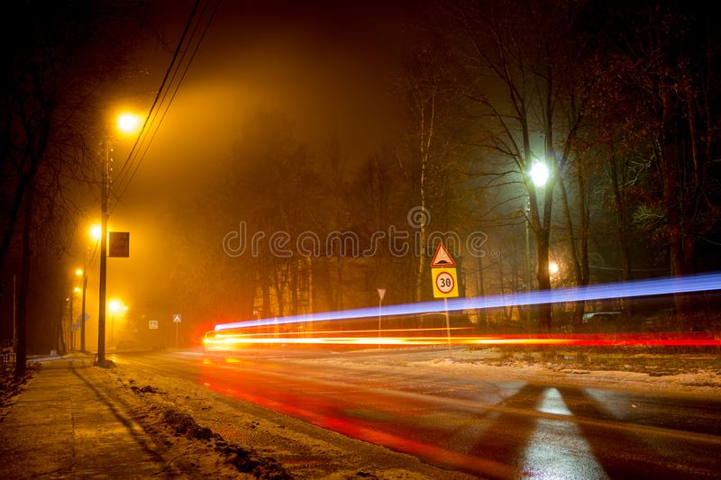 A sleeping area with scattered light during a night fog stock photography