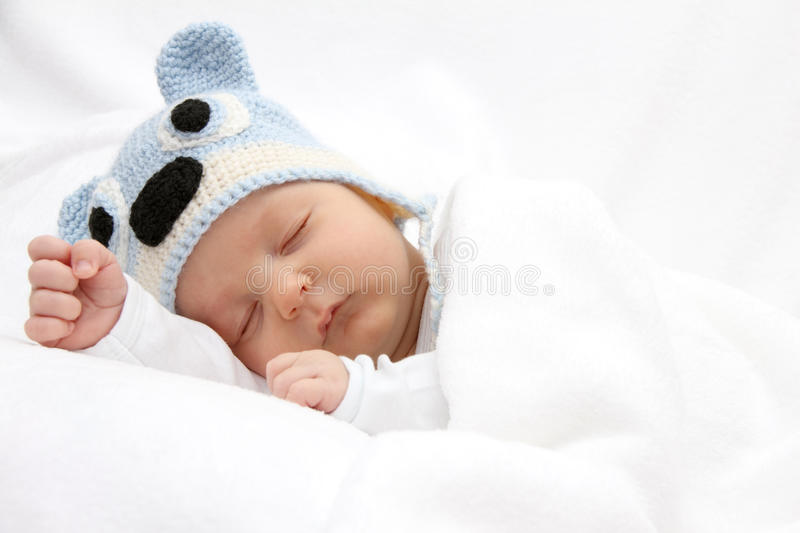 Sleeping baby. With knitted hat