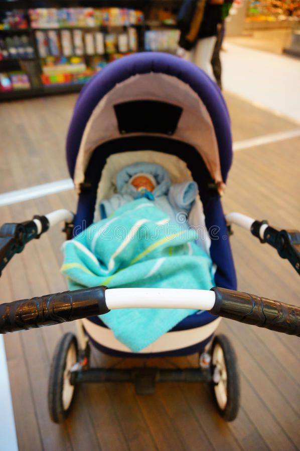 Sleeping baby in buggy. Front part of an buggy with sleeping baby royalty free stock image
