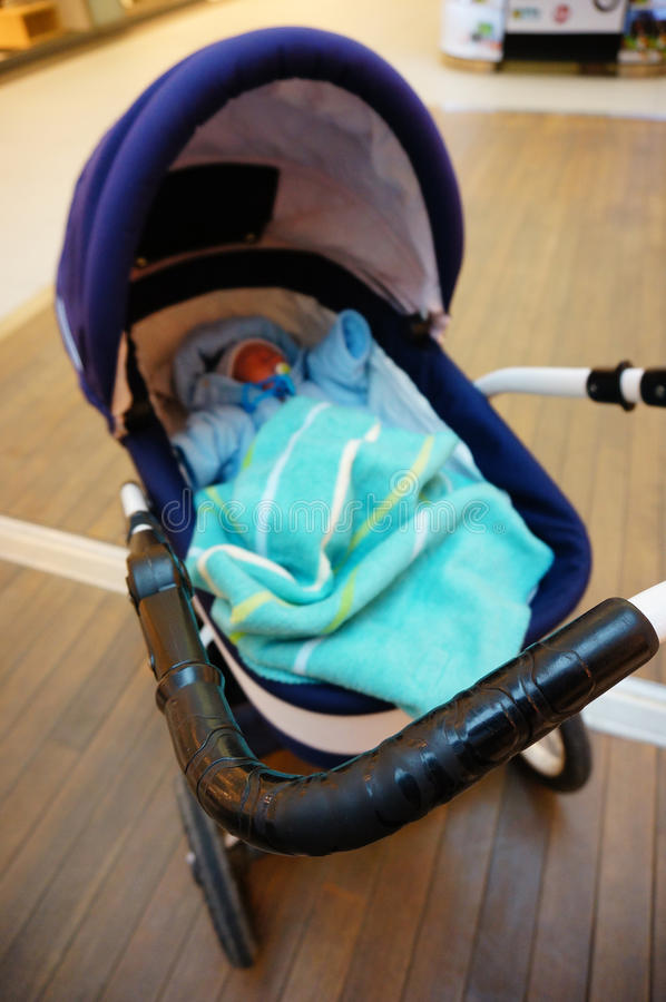 Sleeping baby in buggy. Front part of an buggy with sleeping baby royalty free stock photo