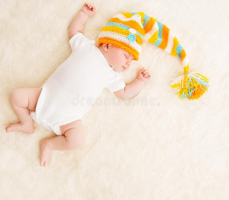 Sleeping Baby, Newborn Kid Sleep In Hat, Beautiful New Born Infant Child. One Month Old stock photo