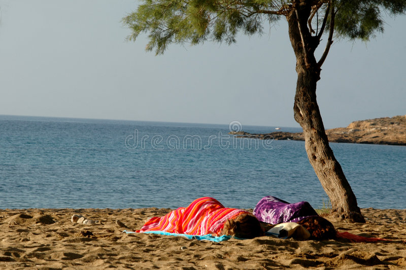 SLEEPING ON THE BEACH Royalty Free Stock Images