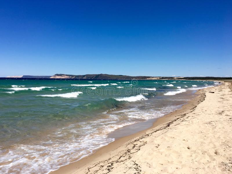 Sleeping Bear Dunes, Lake Michigan. Wild, brisk day on a lonesome stretch of shoreline; with a view of Sleeping Bear Dunes royalty free stock photo