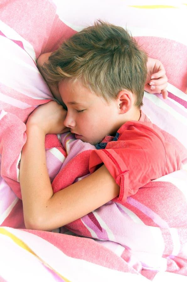 Sleeping boy stock photos