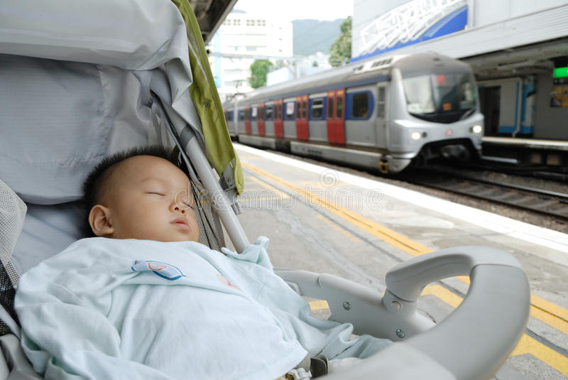 Download Sleeping boy stock image. Image of travel, station, safety - 16246329