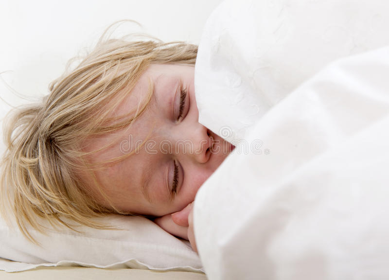 Download Sleeping boy stock photo. Image of eiderdown, young, down - 18303918