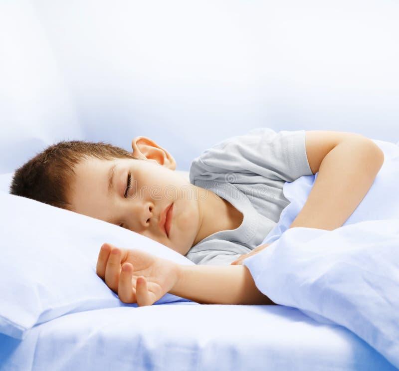 The sleeping boy stock photography