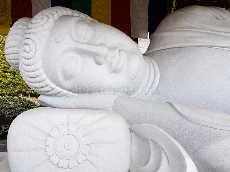 Sleeping Buddha statue stock photos