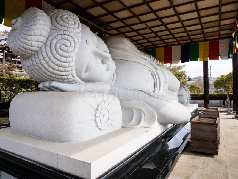 Sleeping Buddha statue stock image