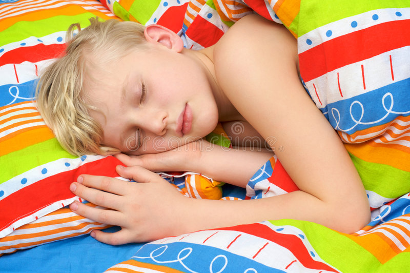 Sleeping child on the bed. Sleeping cute child on the bed stock photography