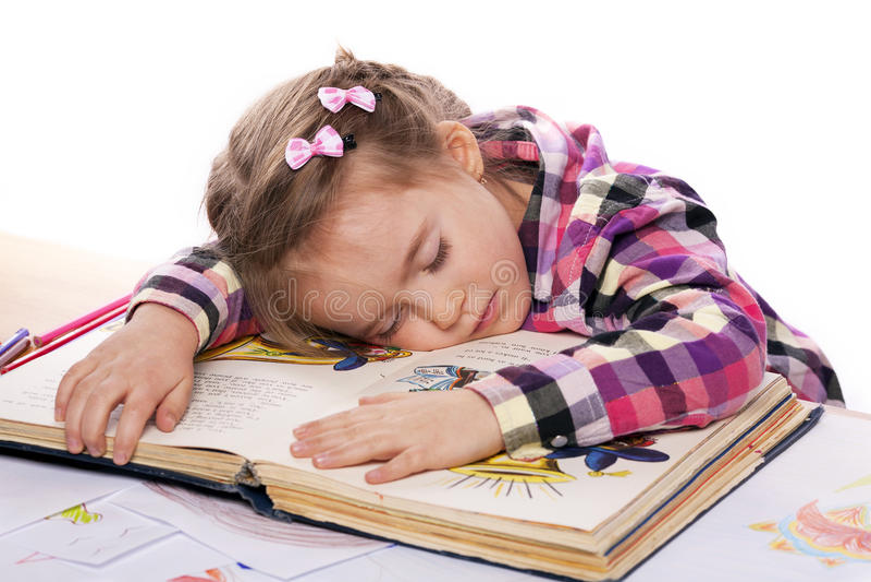 Sleeping Child On A Book Stock Photos