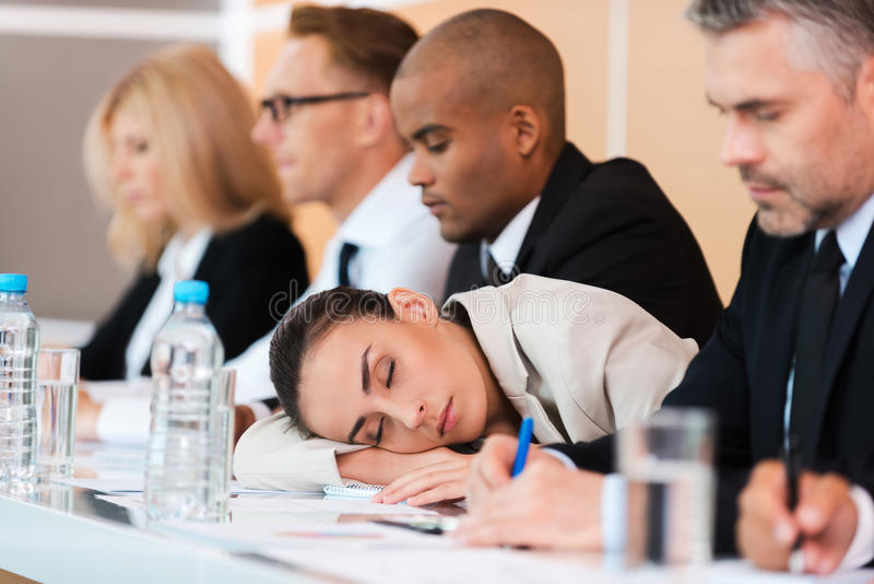 Sleeping at the conference. stock photography