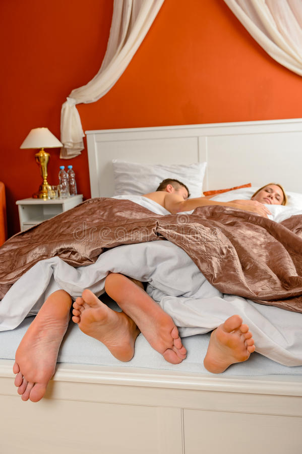 Download Sleeping Couple Barefoot Bed Side By Side Stock Photo - Image: 29247694
