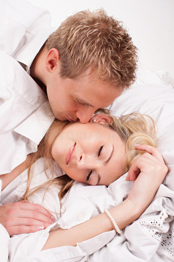 Sleeping couple. Sleeping happy couple lying in bed stock photography