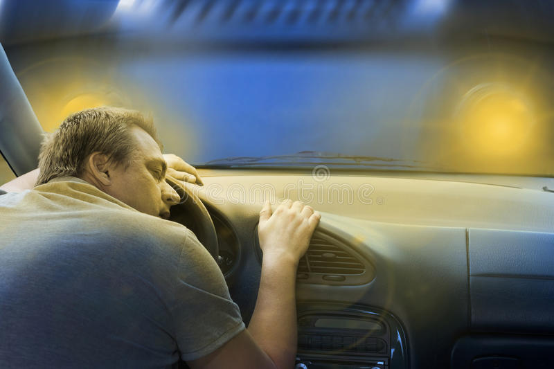 Sleeping driver before his death. Driver sleeping in the car just before a frontal crash with a lorry royalty free stock photo