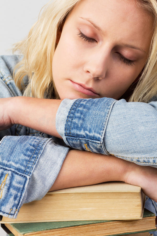 Sleeping female student stock images
