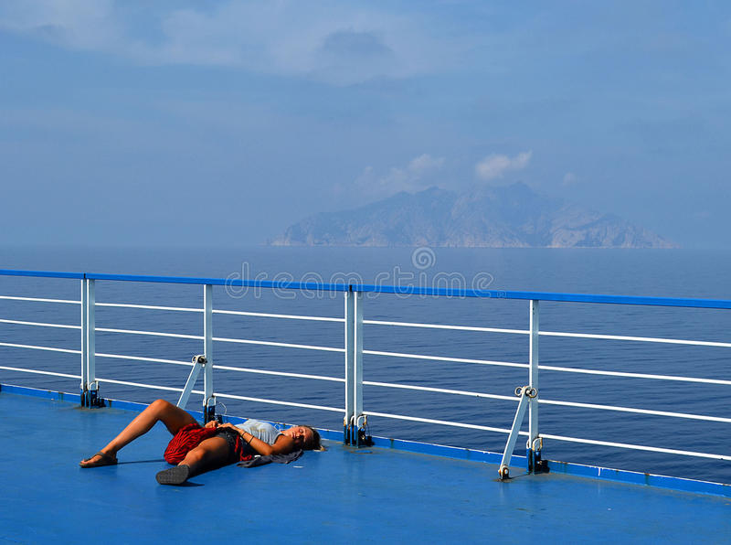 Sleeping on ferry deck stock photography