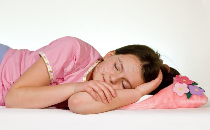 Sleeping girl. Girl sleeping on a white bed stock photo