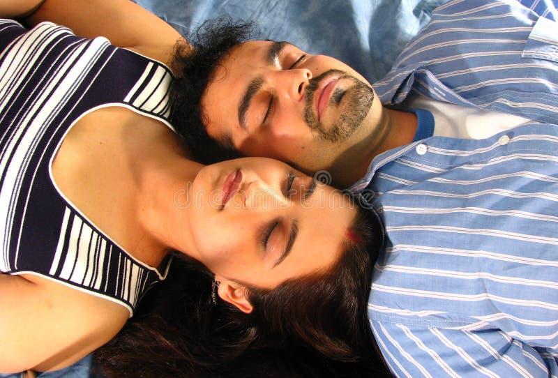 Sleeping Indian couple royalty free stock photography