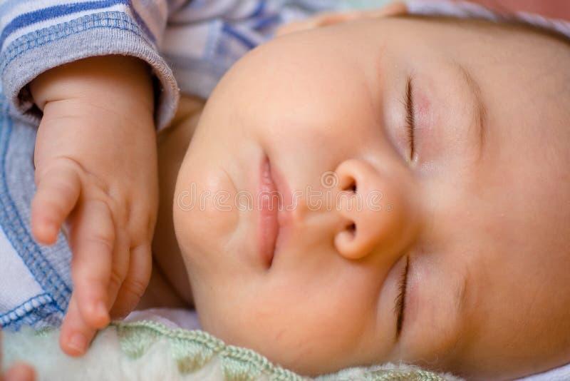 Sleeping Infant. Closeup of a sleeping baby in horizontal format royalty free stock photos