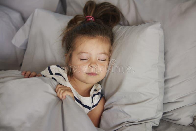 Sleeping little girl royalty free stock images