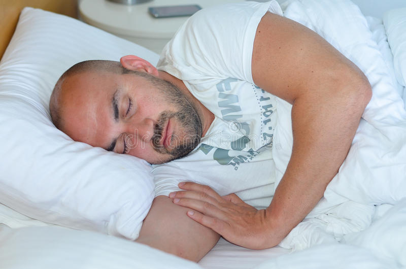 Sleeping man royalty free stock photos