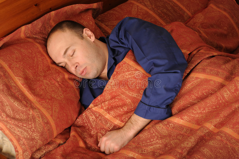 Sleeping Man In Bed Royalty Free Stock Photography