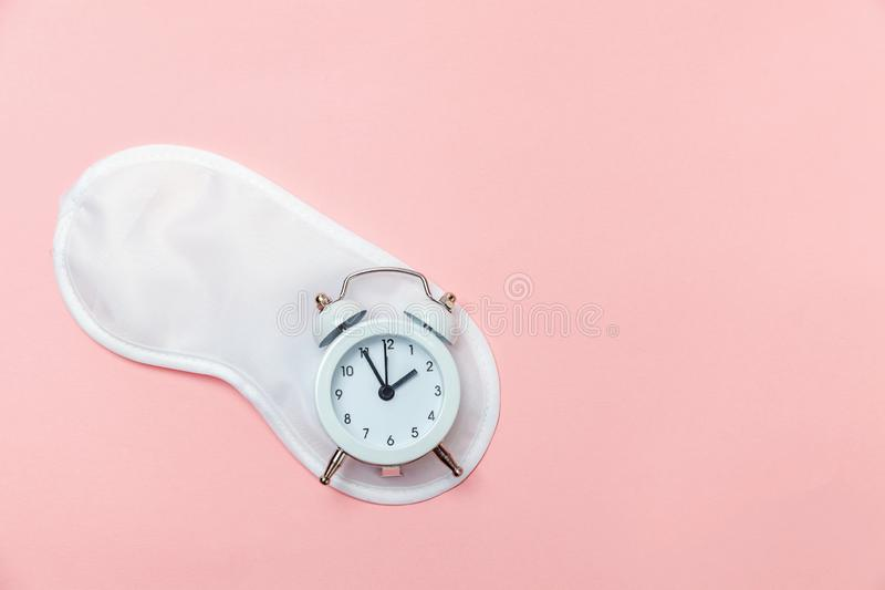 Sleeping Mask And Alarm Clock On Pink Pastel Background ...