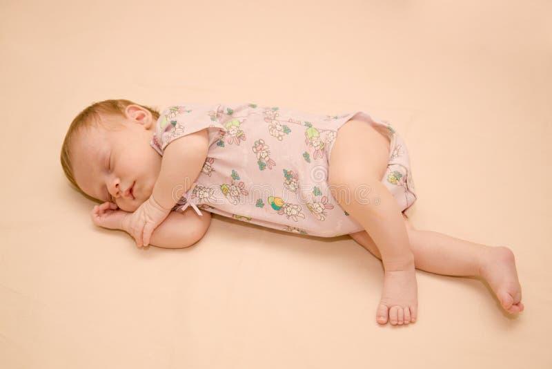 Sleeping newborn stock images