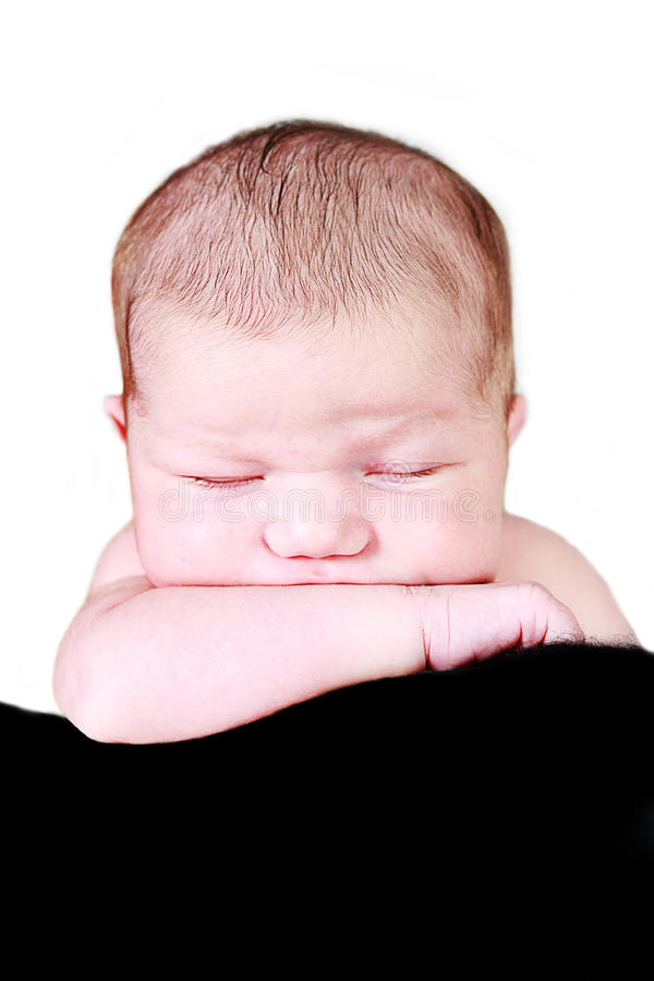 Sleeping newborn baby stock photo