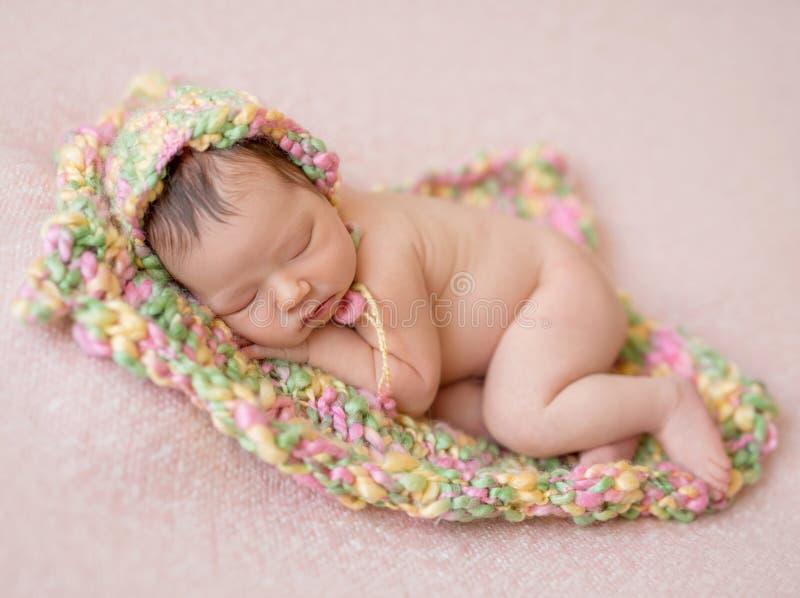 Sleeping newborn baby girl royalty free stock images