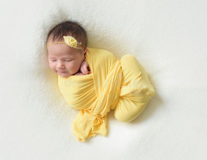 Sleeping newborn baby girl stock photos