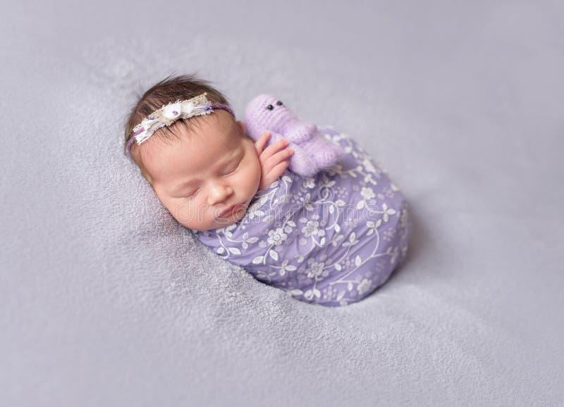 Sleeping newborn baby girl stock photo