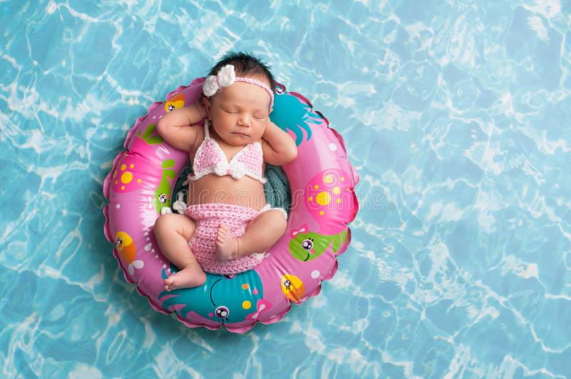 Sleeping Newborn Baby Girl Wearing a Bikini royalty free stock images