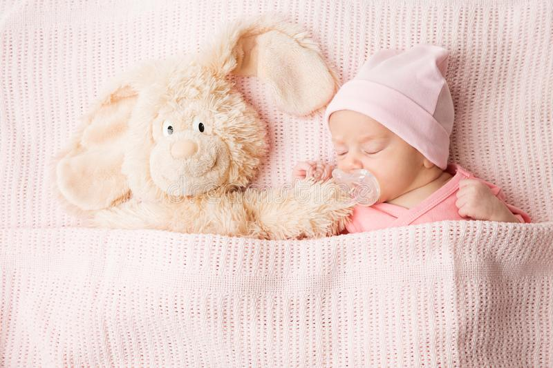 Sleeping Newborn Baby with Toy, New Born Kid Sleep covered by Blanket, Child Portrait royalty free stock photo