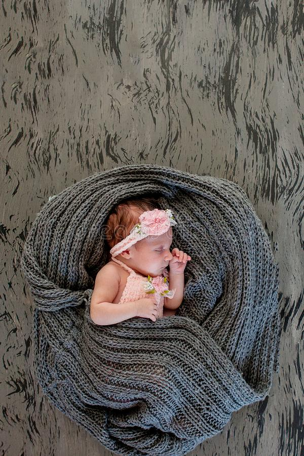 Sleeping newborn girl on a pink background.Photoshoot for the newborn. 20 days from birth. A portrait of a beautiful, seven day royalty free stock photos