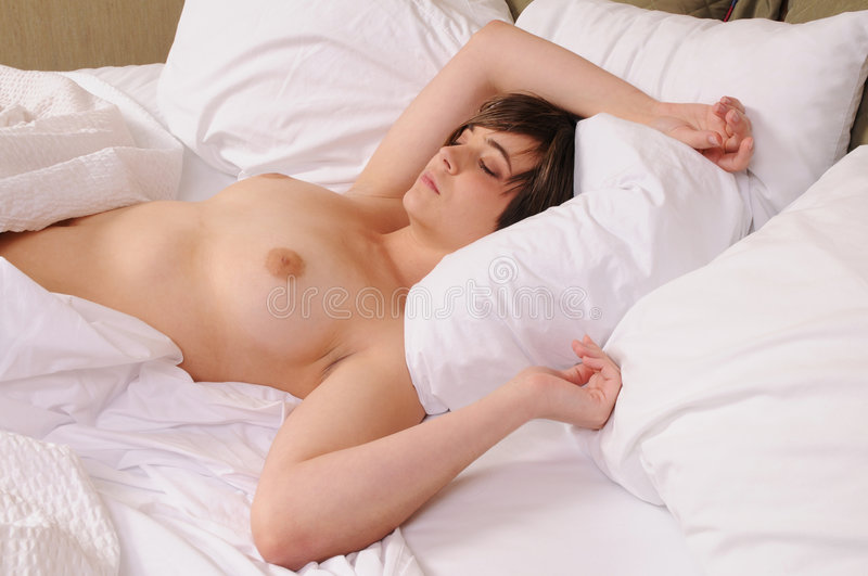 Two nude girls in bed sleeping