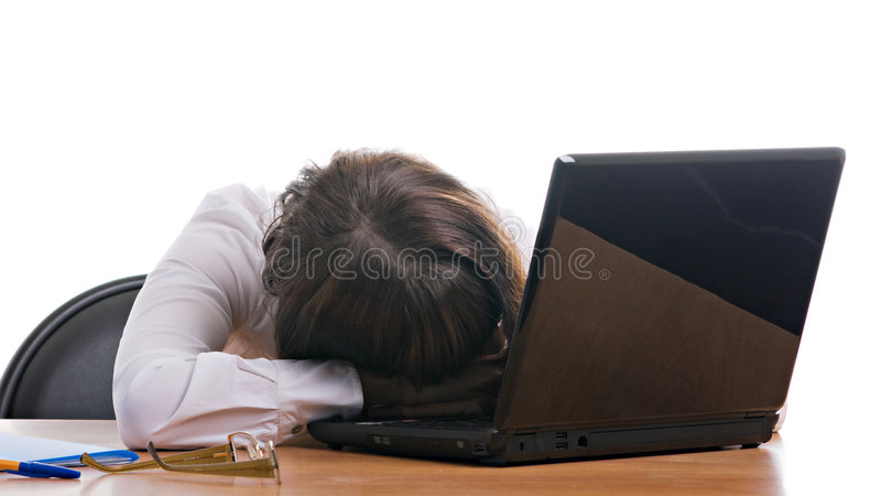 Sleeping office manager. Girl working in the office of fatigue is sleeping on the workplace royalty free stock images