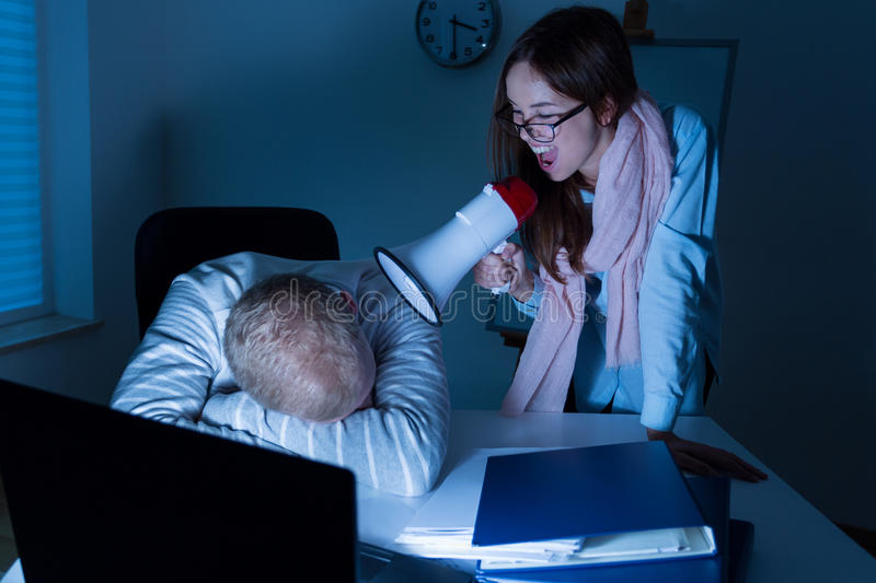 Sleeping in the office stock images