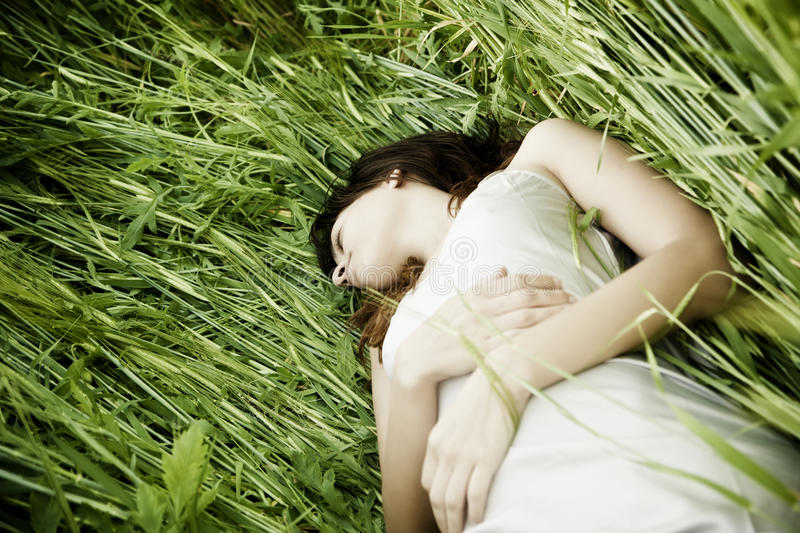Download Sleeping over the grass stock photo. Image of female - 11467262