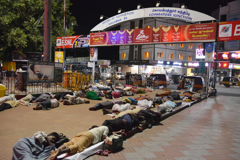 Sleeping people at Coimbatore. Coimbatore, India - October 29, 2015 - Sleeping people at Coimbatore junction railway station royalty free stock photos