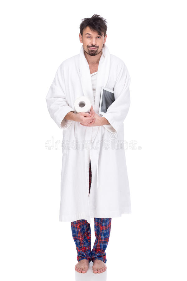 Sleeping. Sleepy man in a bathrobe with paper and tablet. Morning. On a white background royalty free stock images