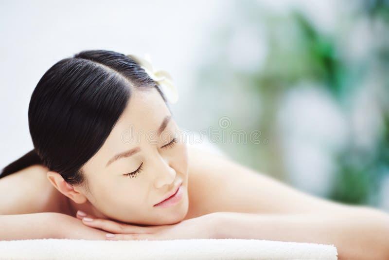 Sleeping at spa salon stock photography
