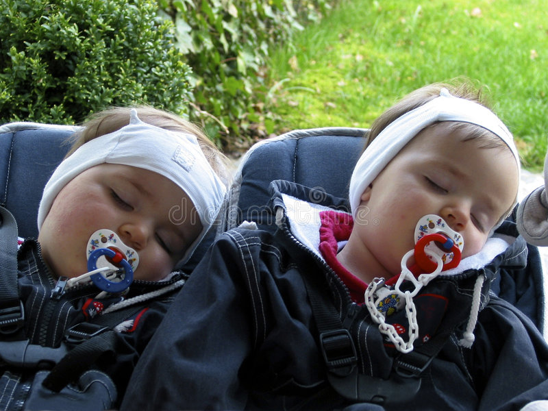 Sleeping twins in the baby carriage (B) royalty free stock image