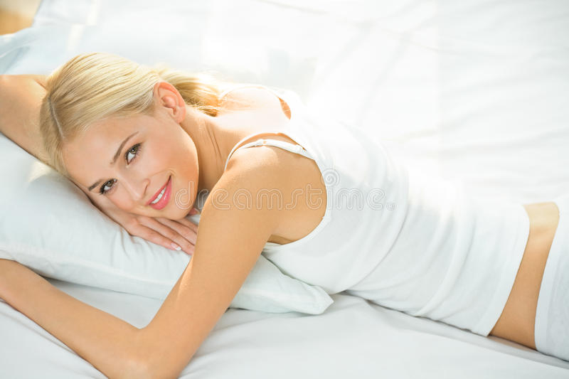 Sleeping woman. Sleeping young woman at home royalty free stock photo