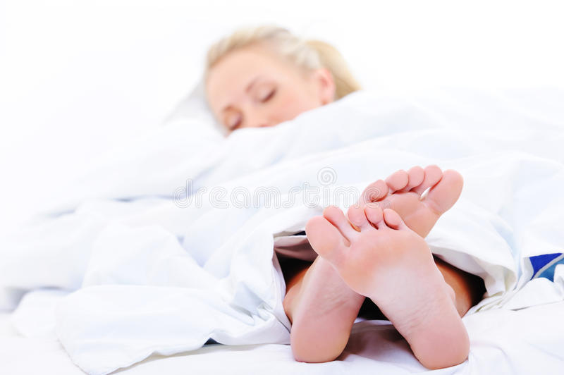 Sleeping woman with a feet on foreground
