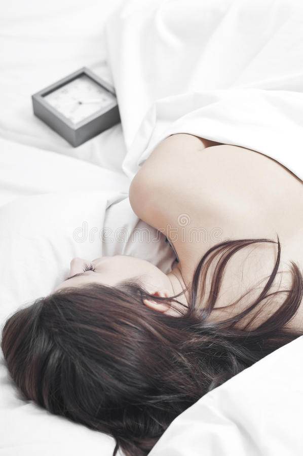 Download Sleeping Woman In White Sheets With A Clock Stock Image - Image of casual, asleep: 21964199