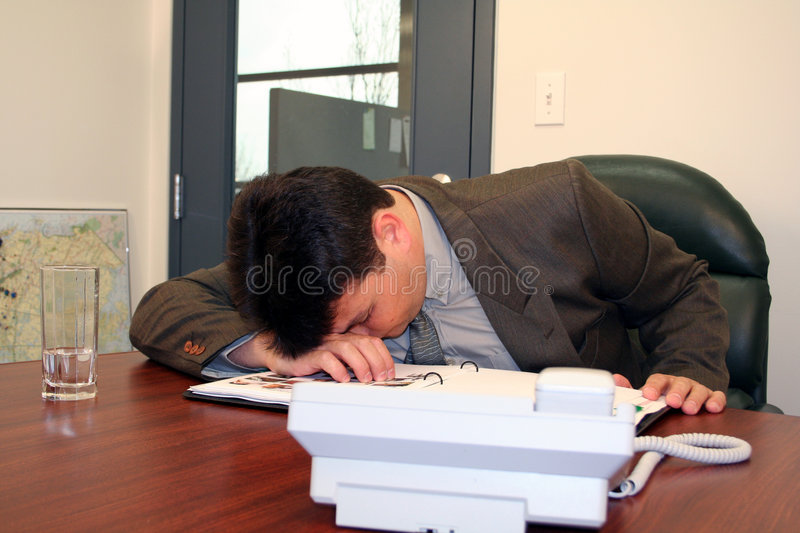 Sleeping at work stock images