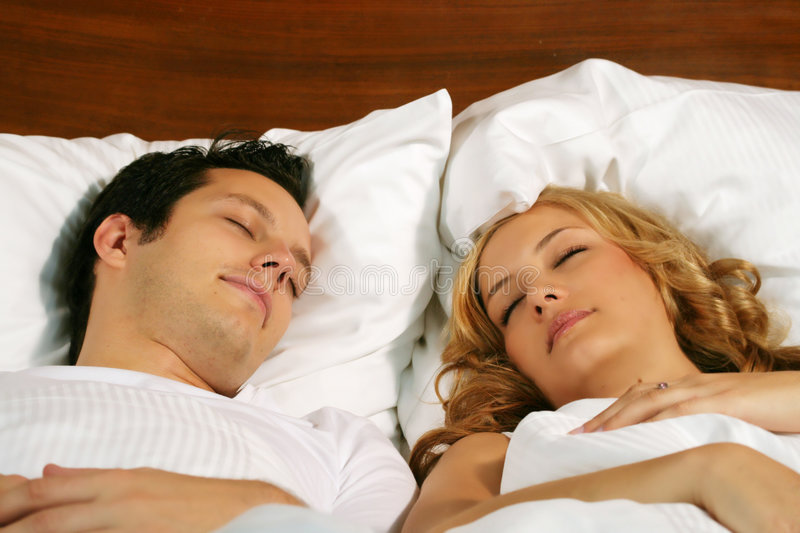 Sleeping young couple stock photo